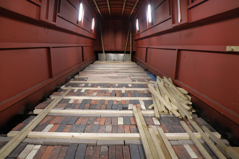 narrowboat ballast neatly positioned ready for sub flooring