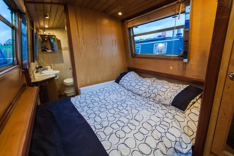 Cross double bed on a narrowboat where the mattress is often in two sections and stowed under the gunwhale