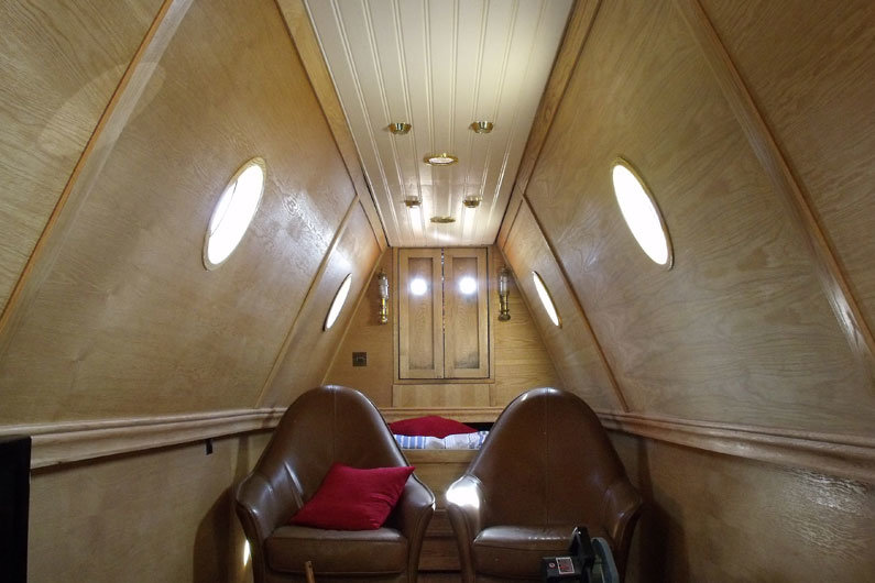Under tug deck bed on a narrowboat that can be pulled out when required