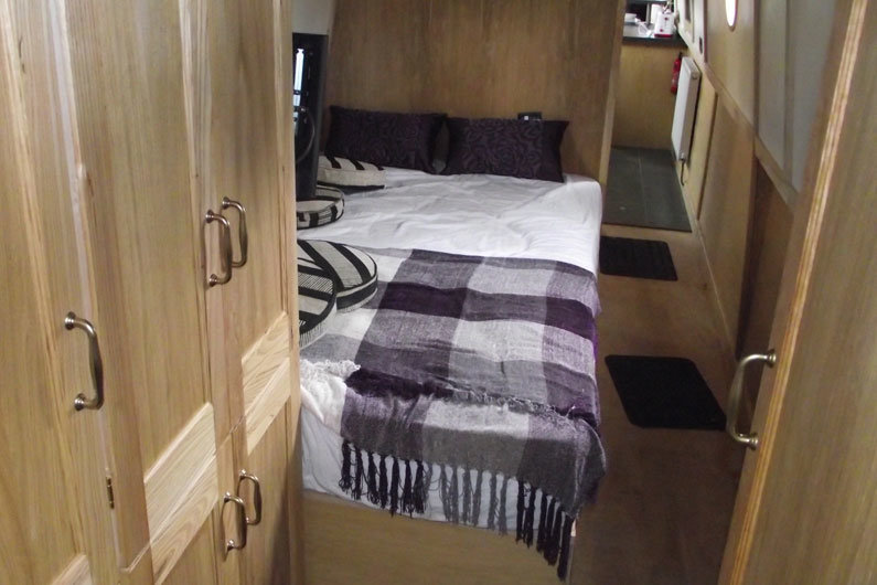 Fixed lengthways bed on a narrowboat, using a 4ft mattress, available from most bed suppliers