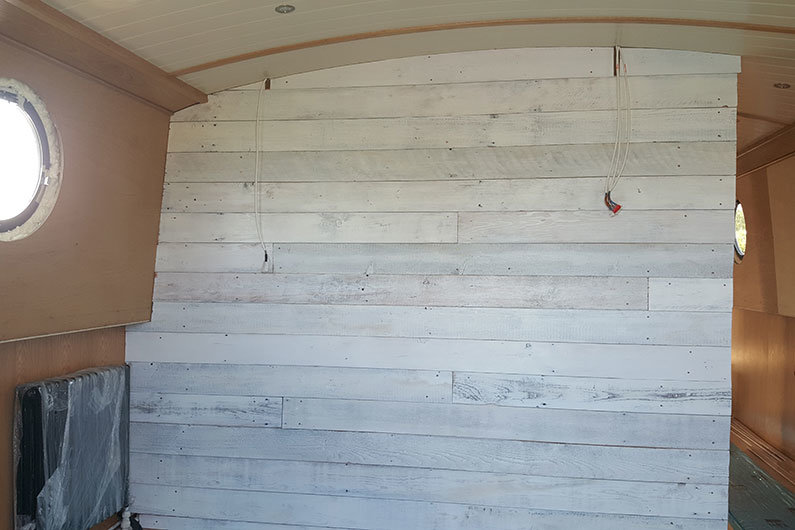 Narrowboat bulkhead clad in white washed ply