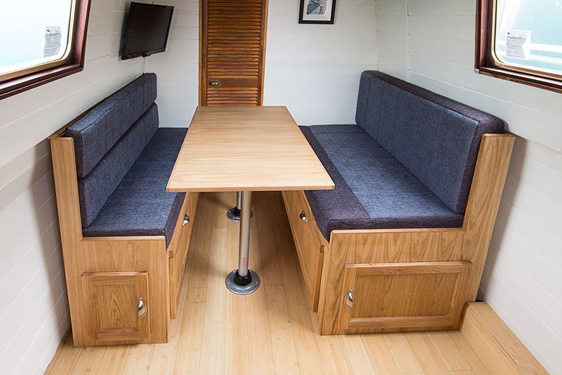 A pullman dinette on a narrowboat can easily be converted in to an additional bed
