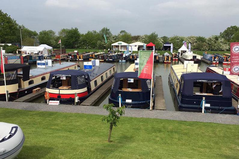 New narrow boats displayed at a boat show