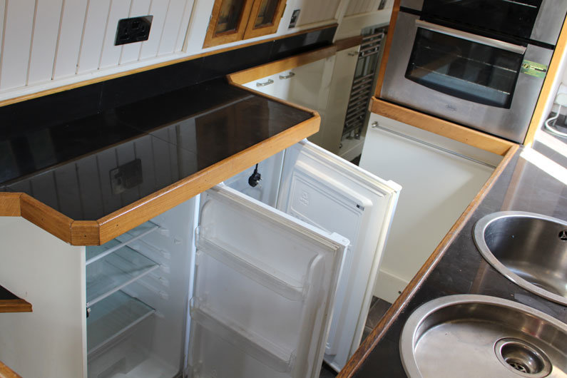 Standard 230v fridge & freezers can be installed on a narrow boat if you have a sufficient power supply. These are considerably cheaper than a 12v fridge / freezer