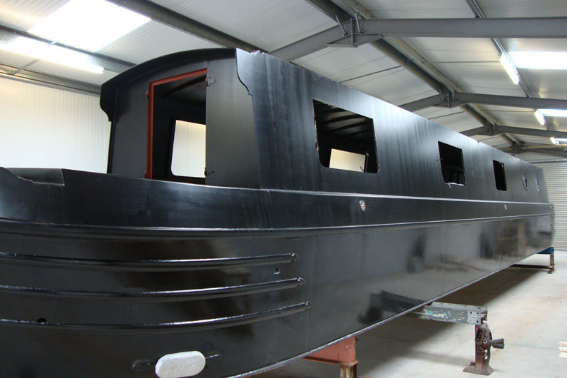 A completed steel narrow boat hull