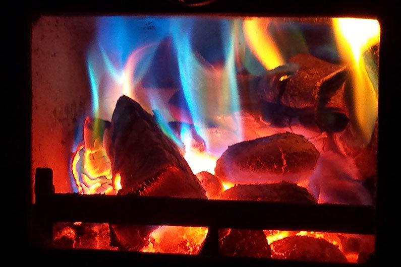 A roaring fire on a narrow boat