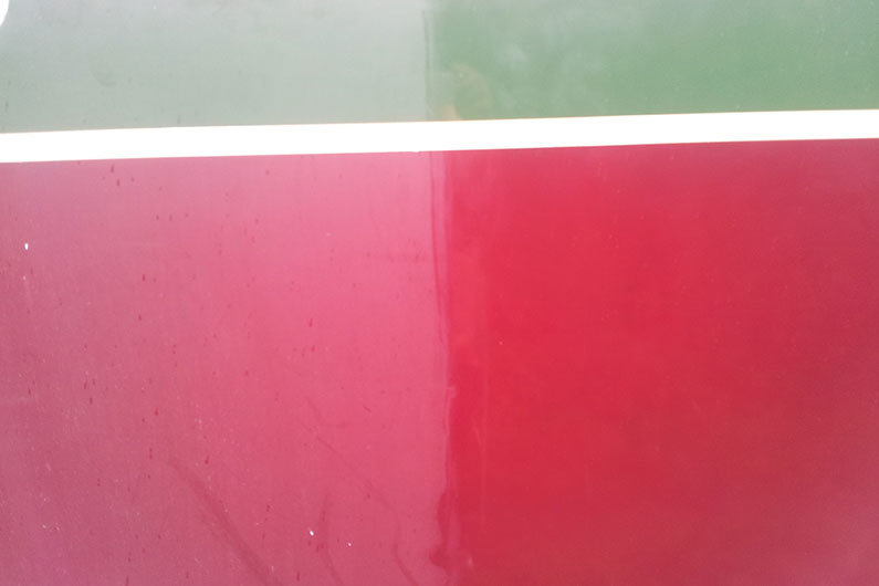 Narrowboat paint work is soon brightened with a good polish and a lot of elbow grease