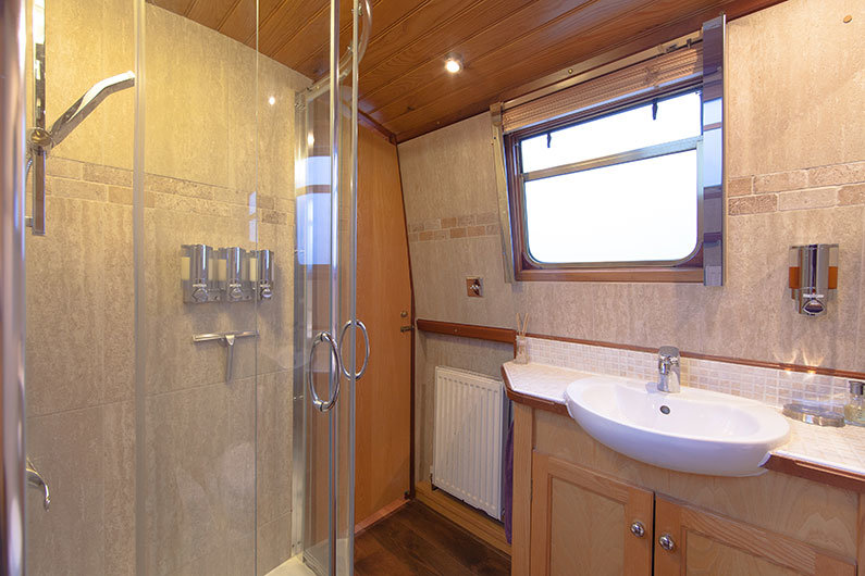 A shower installed on a walk through bathroom on a narrowboat