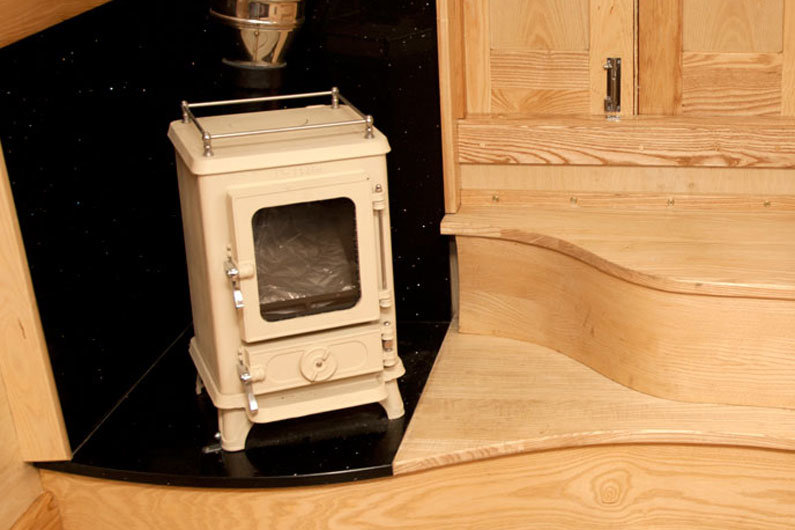 Solid fuel stoves are often found on a narrow boat, however consideration needs to be given to the heavy lifting of fuel