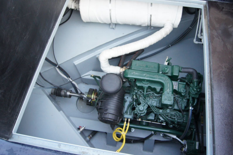 Narrow boat engine bay with diesel engine installed