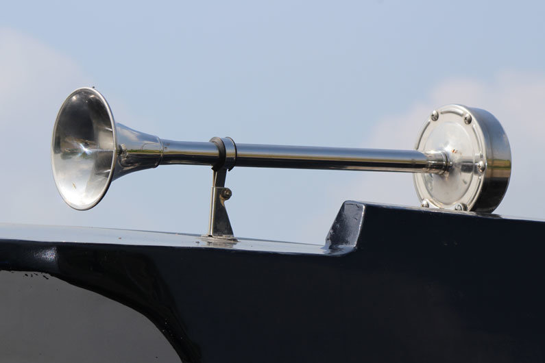 A narrowboat horn is used for alerting others to you coming round a sharp bend and as a distress signal