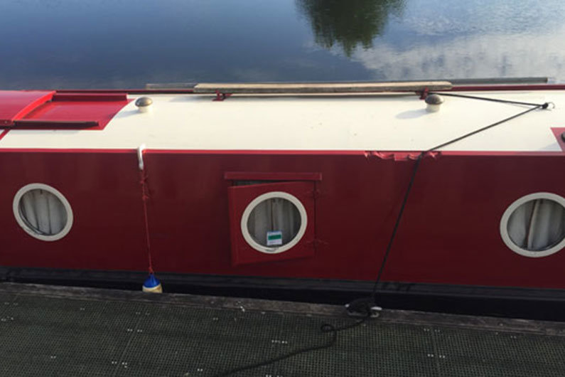A plank on a narrowboat roof can come in very useful when mooring up