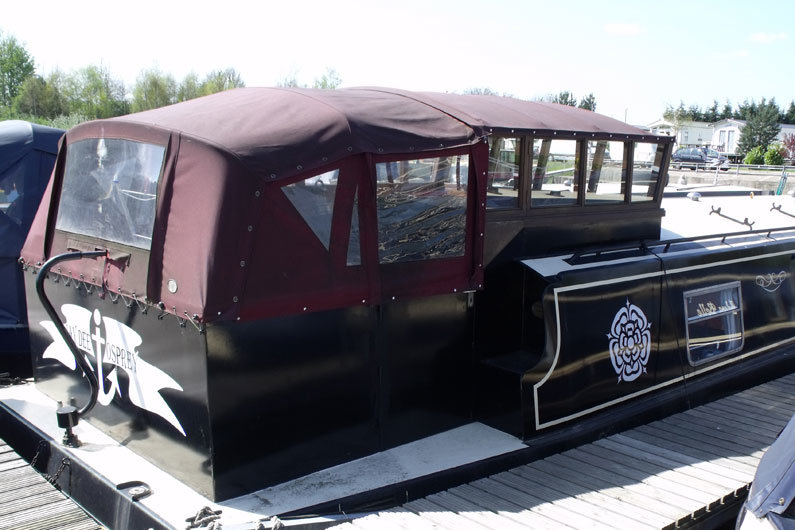 Pram hood cover on a cruiser stern can provide additional living space on a narrowboat