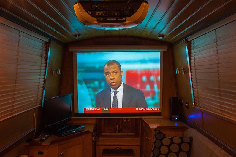 It is possible to run a projector screen & home cinema set up on a narrowboat