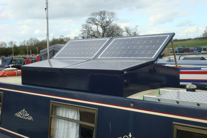 Solar panels on narrowboats are often mounted on storage boxes