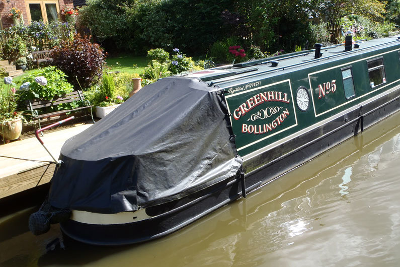 Tonneau covers used to prevent ingress of water & debris on a narrowboat