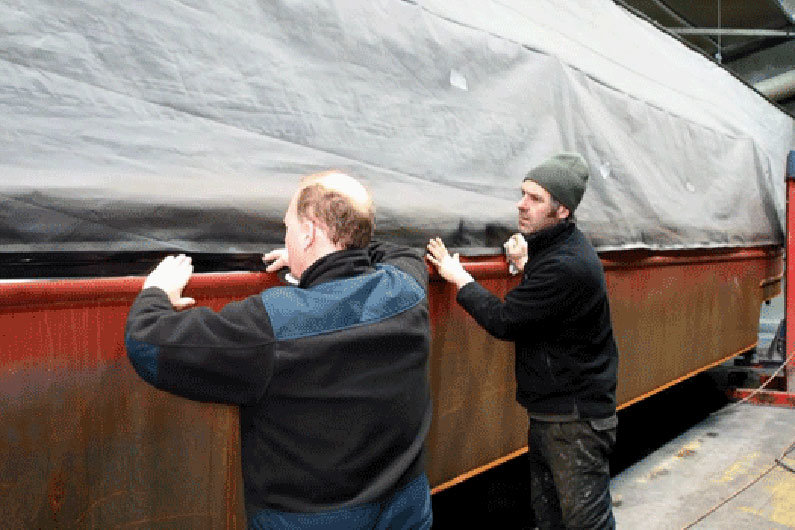 Masking up a narrow boat to ensure no blast media enters boat cabin