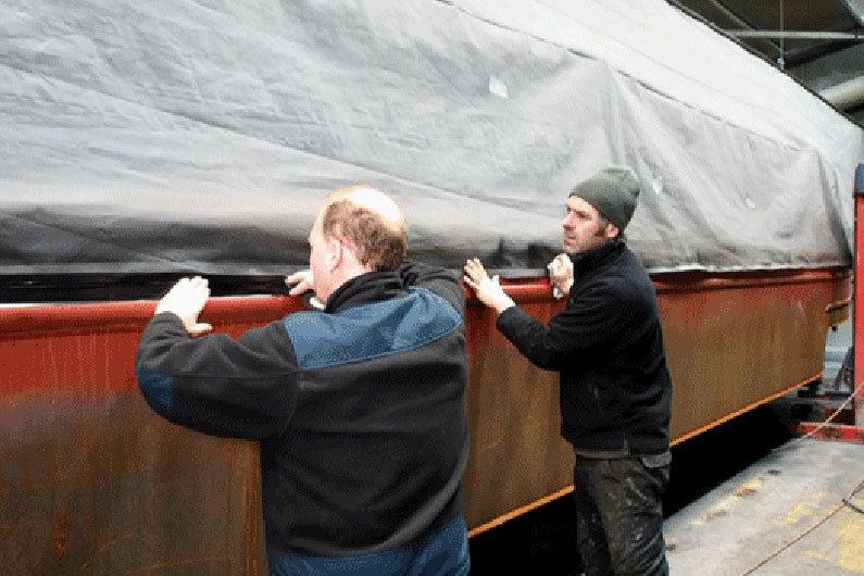 Masking up a narrow boat to ensure no blast media enters boat cabin