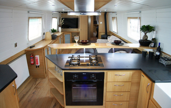 View of the galley in to the saloon on a new widebeam canal boat