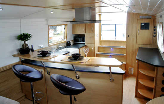 Galley leading out to the stern on a new widebeam fully fitted canal boat