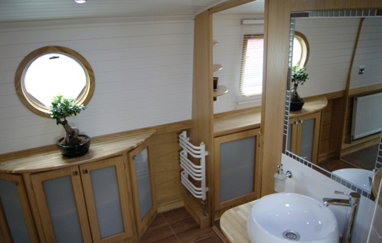 Walk through bathroom on a new fully fitted widebeam canal boat