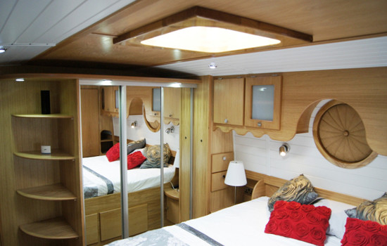 Ample fitted wardrobe space on a new fully fitted widebeam canal boat