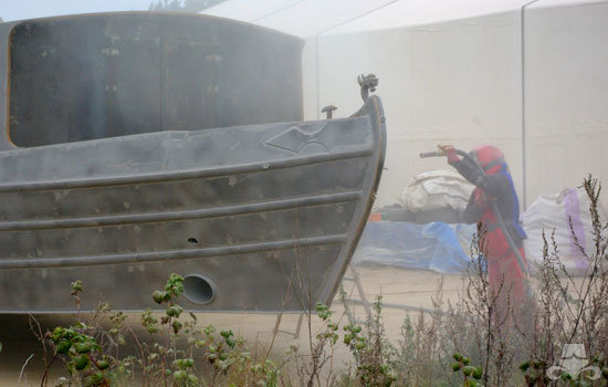 Narrowboat steel hull being shot blasted 04