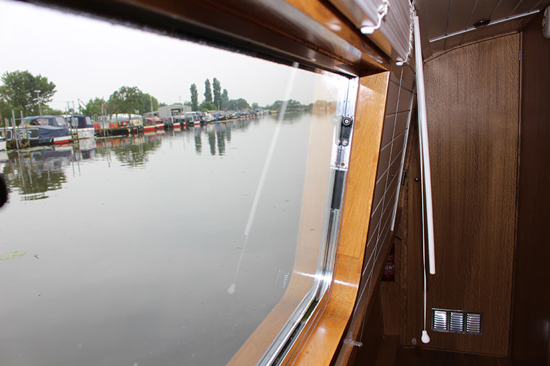 Locking mechanism on a narrowboat window