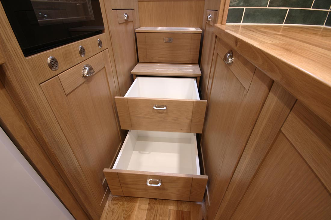 Easy access storage on steps on a new narrowboat built by The Fit Out Pontoon